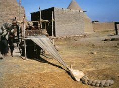 North-west of Lake Titicaca, Peru.    Man weaving on a horizontal foot loom. The warp, weighted by a drag-stone, is similar in concept to West African methods.