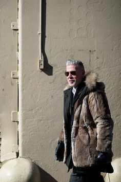 The 20 Best-Dressed People From NYFW, Day 2: Nick Wooster. Yesterday he had just a hint of man-fur, but today it is balls-out full jacket and for that, we commend you.