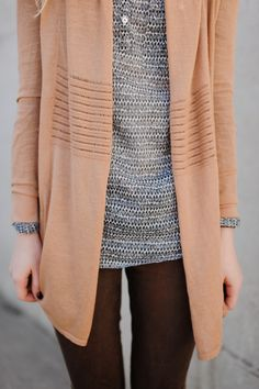 Black and white patterned top, burgundy skinnies with peach colored cardigan.