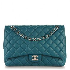 This is an authenticCHANEL Lambskin Quilted Maxi Single Flap in Turquoise. This stylish shoulder bag is crafted of soft and smooth diamond quilted lambskin leather.