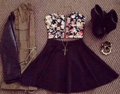 Floral strappless top with black skater skirt, brown jacket with leather sleeves, and black ankle boots