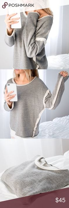 Cloud Fleece Lined Sweatshirt *LAST! ◽️Soft as a CLOUD with plush fleece lining! ☁️ Stylish and sporty design. Wear on the shoulder or off, wear the sleeves long or rolled. Heather gray and creme. Cotton rayon poly. New and high quality. Made in USA. Size M and L available - 1 left in each size (S  sold out).  ▫️I am modeling S ▫️Price firm, no offers 📷 Photos are my own Tops Sweatshirts & Hoodies