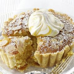 Lemon and almond tarts is part of Desserts If you like Bakewell tart you& love this lemon version A crisp shortcrust shell is filled with lemon curd and a rich egg and ground almond sponge Serve - Lemon Desserts, Lemon Recipes, Tart Recipes, Just Desserts, Sweet Recipes, Baking Recipes, Delicious Desserts, Yummy Food, Sweet Pie