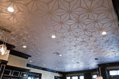 Another shot of the ceiling.  The Imago Dei team won gold for Best of Use of Hard Surface for this kitchen ceiling design! Imago Dei was commissioned by Montgomery Roth Architecture and Interior Design, LLC. to help transform this room that felt scattered and disconnected. The pattern was designed for the client to serve as the unifying feature of this project. Luminescent metallic plaster served as the base while a transparent metallic glaze was used for the hand-painted ceiling pattern.