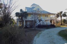 If you have been searching for your dream home at the beach, look no further! This gorgeous home in Waccamaw Lakes is located on an acre lot with lake views and is only a golf cart ride from the ocean plus is has everything you could ever want in a beach cottage. Completely furnished, this 4 bedroom 4 bathroom home is decorated in a coastal décor and has wonderful open floor plan. So many great features including heart pine floors, granite cou...