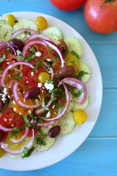 Yum Yum Wednesdays featured recipe is Cucumber and Tomato Summer Time Salad - A light, refreshing Mediterranean salad made with cucumbers tomatoes and topped with a simple balsamic dressing.