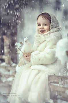 Winter's child ~ snow scene ~ bokeh