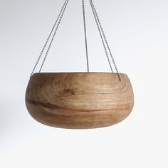 salvaged vintage wood bowl completed with a delicate new chain to make a clean-lined hanging planter with lovely graining. perfect for air plants or