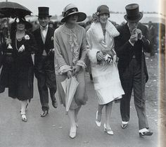 """Ascot Races, 1926 on Flickr.     """"At the Ascot races a woman prepares to put up her umbrella against the rain in 1926. When the weather was sunny, however, parasols were no longer essential accessories, as having a suntan was now becoming fashionable.""""  Scanned from the book """"Decades of Fashion""""."""