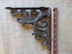 Cast Iron Victorian Style Octopus Shelf by CuriosityShopper