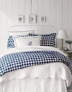 blue and white cottage bedroom.  Love the white paneling.