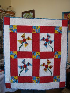 Cat in th Hat Pinwheels Baby Quilt by LogCabinCountyQuilt on Etsy
