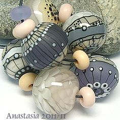 Anastasia.  I love the translucent bead.  I couldn't get to it via this link though.  Pin for inspiration