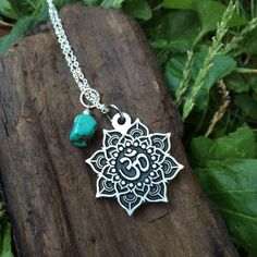 Lotus Flower Mandala and Turquoise Pendant Necklace. Lotus Mandala with OM symbol - silver tone metal Pendant approximately 30mm and free form Turquoise bead. Sterling Silver bead chain 18 inches (46cm) long. The Lotus flower represents life, beauty, respect, clarity of heart,