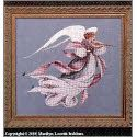 "Lavender & Lace counted cross stitch pattern 'Angel of Spring' -  Made this for my sister the Christmas after ""Angel of Winter"". She had all four of them above her fireplace."