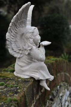 angels blowing a kiss - if you find her, I want one:)