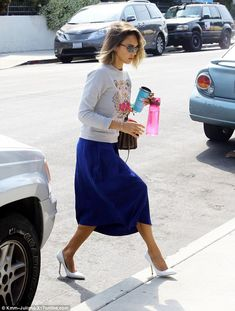 Step up: The flowing blue skirt allows the actress to walk freely across the street while ...