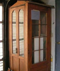 A phone booth from reclaimed French doors!!  Wow.    There are tons of DIY Craft Projects using Old Vintage Windows Doors - Trash to Treasure - Architectural Salvage