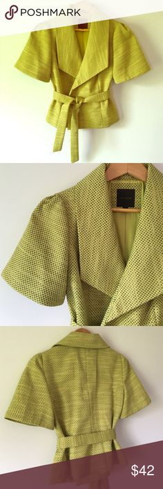 "The Limited Short Sleeve Blazer Adorable belted, puff shoulder, wrap-style blazer. Chartreuse tweed with a hint of gray. Looks great dressed down with a fitted tee and jeans or as a piece for your office attire. Approx 18"" pit to pit. 21"" shoulder to bottom of hem. 72% polyester 28% cotton. Fully lined. EUC The Limited Jackets & Coats Blazers"