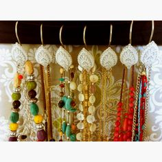 use shower curtain hangers to display long necklaces and costume jewelry! just hook them wherever (I hooked mine to the bottom of a ribbon board that was mounted on our wall) and enjoy! cute and cheap!