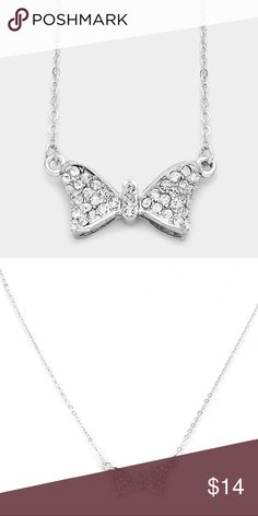 "Crystal Bow Pendant Necklace [grandavenue: 319141] • Color : Clear, silver • Theme : Bow  • Necklace Size : 18"" L • Pendant Size : 1"" X 0.5"" • Crystal pave bow pendant necklace Jewelry Necklaces"