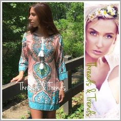 """Tangerine @ Turquoise Tunic Dress On trend print shift dress in a pale trangerine and turquoise  color print. 3/4 length sleeves, V neckline and tassel detail. Made of rayon, non sheer, lightweight. Sizes S/M, M/L, L/XL                                           S/M Bust 42"""" Length 34""""  M/L Bust 44"""" Length 35""""  L/XL 46"""" Length 35"""" embellished striped crochet Threads & Trends Dresses"""
