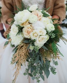 Winter white bridal bouquet // Lauren Fair photography // http://blog.theknot.com/2013/12/16/a-cozy-and-glitzy-winter-wedding/