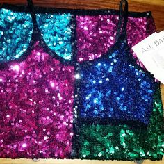 Sassy Sequin NYES Party! By A.J.Bari, NWT Vintage cocktail dress. This interesting little dress is perfect for New Years Eve. All eyes will be on you when that ball drops! The colors you see are the colors of the dress; fushia, green, teal and a medium blue. As far as I can find there are no sequins missing and there are extras attached. There are black seed beads on the straps. Says sz 12, (measurements are 17 in all the way down). Length from underarm to hem is 26 in. Vintage Dresses