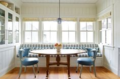 """""""The breakfast chairs are covered in faux leather; the striped fabric on the banquette is from Cowtan and Tout. The hanging fixture from Teka was treated with vinegar to create patina."""" Cannon Falls, Minn., home of Kathy and Dennis Brekken. Photo: Jane Beiles for the New York Times. """"The Innkeepers"""" by Sandy Keenan - NYTimes.com (May 29, 2014)."""