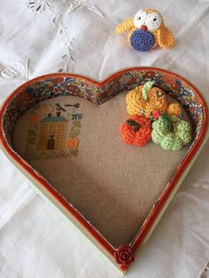 Cross Stitch mounted in fabric lined heart-shaped wooden box...
