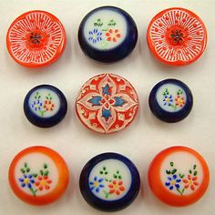 Vintage red and blue painted enamel buttons