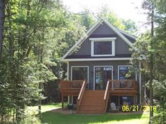 Sunset Getaway, a new four bedroom, three bath home on the east shore of Big St. Germain Lake.