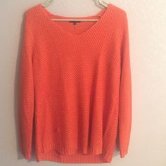 """Francesca's """"hint of sparkle"""" Orange Sweater Bought at high-end local boutique   Perfect light knit sweater. Very subtle sparkle, but just enough. Very small pulling in one spot on the sweater as shown. Besides that, great condition. Worn one time for a game day🏈 Sweaters Crew & Scoop Necks"""