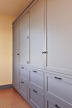 A wall of built-in cabinets provides plenty of room to store clothes and accessories in the bedroom.