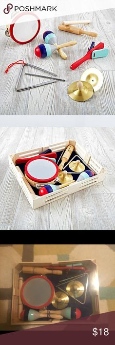 "Melissa and Doug Band in a Box Nod exclusive A Melissa and Doug design Includes triangle, tambourine, rhythm sticks, cymbals, clapper and maracas to soothe your savage beasts Wooden storage box included Show 'em what you're made of Solid wood maracas with beans Solid wood clapper and rythm sticks Metal cymbals and triangle Solid wood tambourine frame with metal discs and elastic drum skin. Pinewood crate. Width: 14.5""  Depth: 11""  Height: 3"" Accessories"