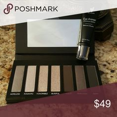 Younique Moodstruck Addiction Shadow Palette #2 with eye primer. Seven  of pearl, shimmer and matte grey tones. Younique  Makeup Eyeshadow