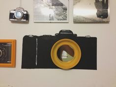 camera painted on the wall, round yellow mirror used as the lens.