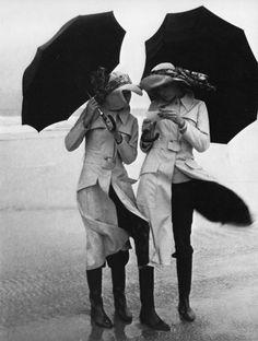 Photo by Guy Bourdin, 1971 by silvia at the beach windy day umbrella Guy Bourdin, Edward Weston, Ansel Adams, Windy Day, Rainy Days, Rainy Night, Black White Photos, Black And White Photography, Monochrome Photography