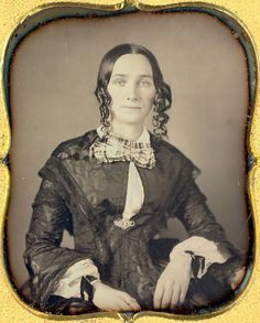 Could a girl have a sweeter, gentler face? From the long, pointed waist of the bodice to the under-pinned sleeves to the exposed camisette to the ring on the forefinger to the long side curls to the wrist ribbons, this is a girl of the 1840s.