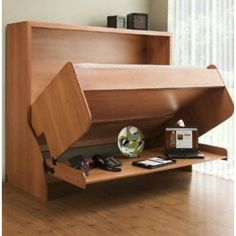 The Hiddenbed is a multi-functional desk and bed combination that is perfect for any small space or home office.  Picture shown is Bed Size: Full  Color: Medium Sycamore Transition View