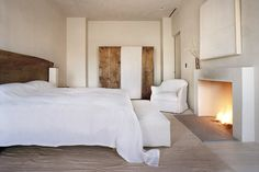Vervoordt whitewashed the door of the wardrobe in the master bedroom himself, one of many handmade elements in the suite. Above the fireplac...