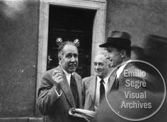L-R: Niels Bohr, Max Born, and Max Delbruck stand talking at the Copenhagen Conference at the Bohr Institute. This photograph was originally image number 32 in an album owned by Victor Weisskopf. Credit line: Photograph by Paul Ehrenfest, Jr., courtesy AIP Emilio Segre Visual Archives, Weisskopf Collection