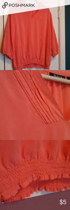 Pink blouse Pleating around the v-neckline 3/4 sleeves Flowy, light fabric ana woman Tops
