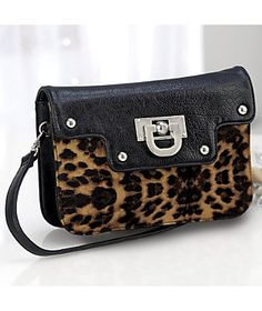 Leopard Clutch Bag from Monroe and Main. $79.95. Elegance with just a hint of a wild side. www.monroeandmain.com