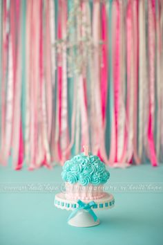 baby first birthday cake smash portrait photographer; love the streamer background for smash pics @Beth Malonoski...David's bday pictures balloons streamers and a cupcake with the number 6 candle...