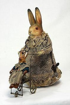 German Mechanical Wind Up Rabbit Pushing Carriage c.1910