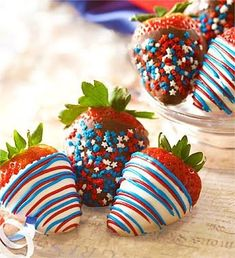 White chocolate and chocolate dipped strawberries with sprinkles.