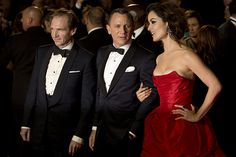 Ralph Fiennes, Daniel Craig and Berenice Marlohe pose together as the actors arrive for the royal world premiere of the James Bond film Skyfall at the Royal Albert Hall in London