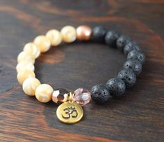 • Opposites Attract! Mother of Pearl and Lavastone Bracelet - Beaded Bracelet with OM Charm - Womens Yoga Bracelet - Valentines Day Gift - Lotus &