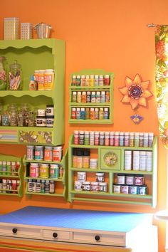Re-purpose mismatched wooden shelving units...spice racks, knick-knack displays, paper towel holders, etc...into stylish storage for your craft materials.  DIY by Infarrantly Creative.